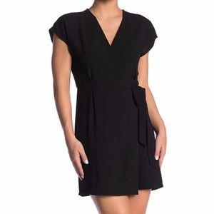 Beautiful cap sleeve crepe wrap dress in black.